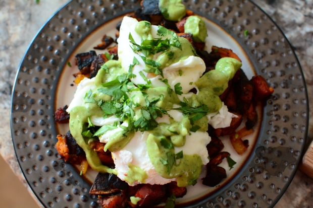 Paleo sweet potato hash with poached eggs and guacamole